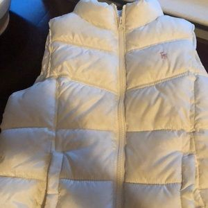 Sleeveless zip up vest